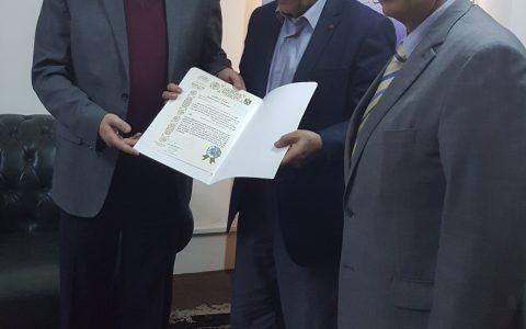 Mr. Hussein Zangana receives the Certificate